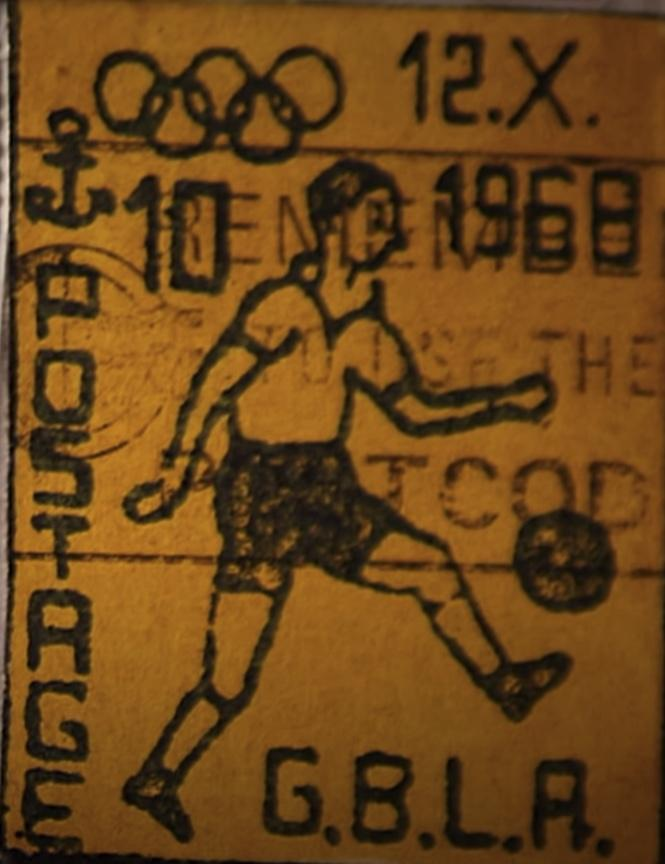 G.B.L.A. Stamp featuring a dude playing soccer and the Olympic rings